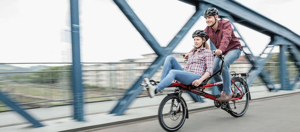 Woman and man riding a Tandem Pino Allround