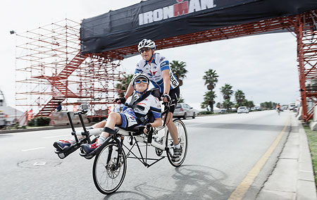 Nicholas and his father riding a Tandem Pino Allround in race gear