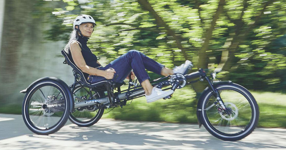 Woman riding a Hase EVOLUTION recumbent trike