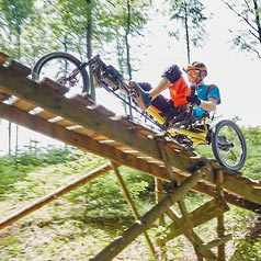 Riding the Kettwiesel Cross Steps recumbent trike over a bridge seen from below