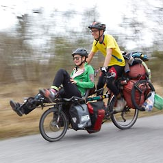 Man and woman riding a Tandem Pino Tour with cargo