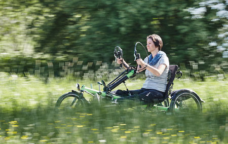 Woman riding a handbike in the country