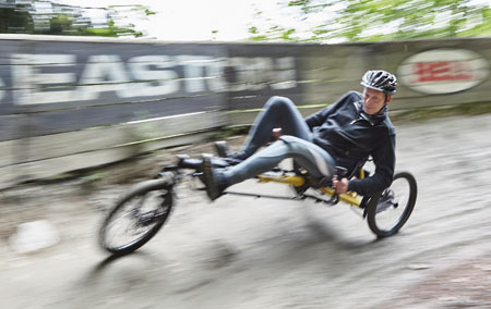 Gunther riding a Kettwiesel Kross recumbent trike through a turn