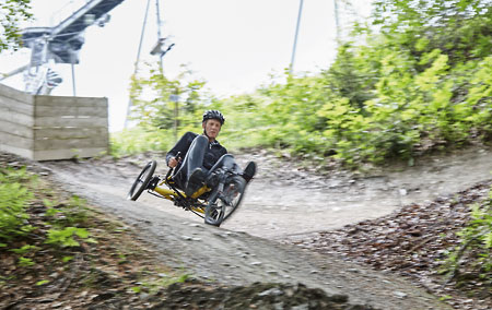 Gunther riding a Kettwiesel Kross off-road recumbent trike down a hill